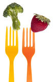 Broccoli and Strawberry on Vibrant Fork stock photo