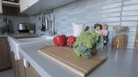 Broccoli and sweet peppers on the board. vegetables on a cutting board stock footage