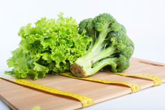 Broccoli with tape measure Stock Images