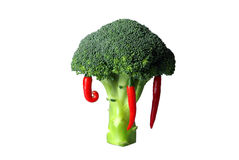 Broccoli and three red hot chili peppers. Green broccoli head and three red hot chili peppers on white background Royalty Free Stock Photo