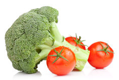 Broccoli and Three Tomato with drops Isolated Royalty Free Stock Photography