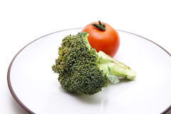 Broccoli and tomato Stock Photography
