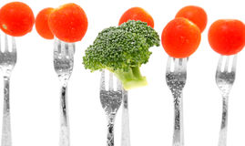 Broccoli and Tomatoes. On forks over white Royalty Free Stock Photo