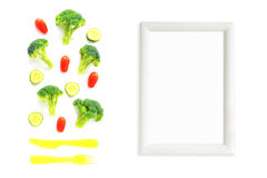 Broccoli, tomatoes and cucumbers composition with cutlery and frame Royalty Free Stock Image