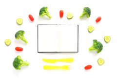 Broccoli, tomatoes and cucumbers composition with cutlery and notebook Stock Photography