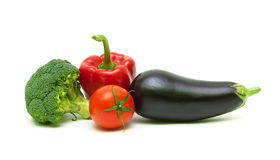 Broccoli, tomatoes, eggplants and peppers isolated on white bac Royalty Free Stock Images