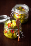 Broccoli and turmeric pickles Stock Images