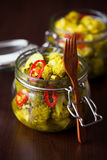 Broccoli and turmeric pickles Royalty Free Stock Photo