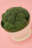 Broccoli in a Vintage Dish on a Pink Background Stock Photos