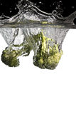 Broccoli in water. Some broccoli falls in water stock photos
