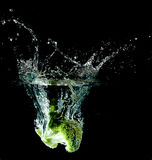 Broccoli Water Splash. Asparagus drop in a water tank creating a splash Stock Image