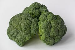 Broccoli  on white background. Pieces of fresh broccoli  on white background Royalty Free Stock Photo