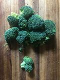 Broccoli on the wood cutting board. Broccoli on cutting board top view Royalty Free Stock Photos