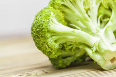 Broccoli on wood table Royalty Free Stock Images