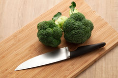 Broccoli on wooden board Royalty Free Stock Photos
