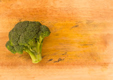 Broccoli on wooden background Stock Photos