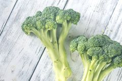 Broccoli on the wooden table. Fresh broccoli on the wooden table: top view Royalty Free Stock Photos