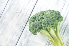 Broccoli on the wooden table. Fresh broccoli on the wooden table: top view Royalty Free Stock Image