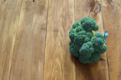Broccoli on the wooden table. Fresh green broccoli on the wooden table Stock Images