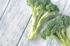 Broccoli on the wooden table. Fresh broccoli on the wooden table: top view Stock Images