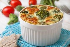 Broccolieldfast form med ägg royaltyfria foton