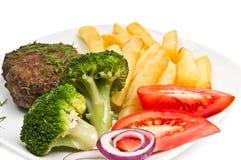 broccolikotletten steker löktomaten Royaltyfria Bilder