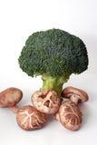 Broccolo e funghi Fotografia Stock