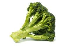 Broccolo su bianco fotografie stock