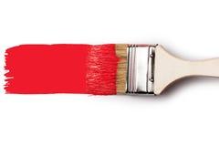 Brocha con la pintura roja Foto de archivo libre de regalías
