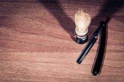 Brocha de afeitar y hoja de afeitar, fotografía de archivo libre de regalías