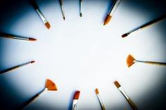 Brochas de los artistas en espacio de la copia del círculo Fotografía de archivo libre de regalías