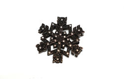 Broche argentée sous forme de flocons de neige Image stock