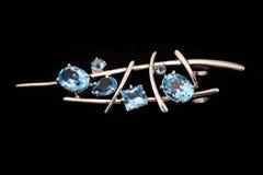 Broche de bijou avec le topaz bleu Images stock
