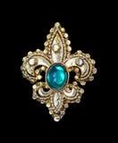 Broche esmeralda imagen de archivo libre de regalías