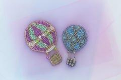 Broches perlées sous forme de montgolfiers ou ballons Image libre de droits