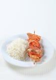 Brochette de porc avec du riz photo libre de droits