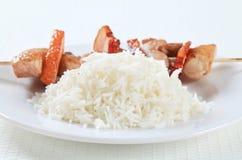 Brochette de porc avec du riz photographie stock