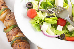 Brochette with Greek salad Royalty Free Stock Photography