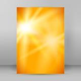 Brochure chaude de la page A4 de tache floue de fond de jaune de lueur Photographie stock libre de droits