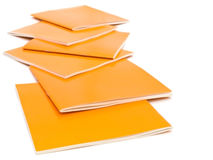 Brochures. Photo of the some orange brochures against the white background royalty free stock images