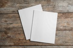 Brochures with blank cover on wooden background, top view. stock photos