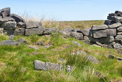 Brocken dry stone wall on moorland Royalty Free Stock Image