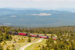 Steam train climping the tracks towards the top of Brocken Mountain. Brocken Germany - May 27. 2017: Steam train climping the tracks towards the top of Brocken stock images
