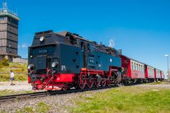 Steam train leaving Brocken train station. Brocken Germany - May 27. 2017: Steam train leaving Brocken train station Stock Images