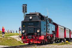 Steam train leaving Brocken train station. Brocken Germany - May 27. 2017: Steam train leaving Brocken train station Royalty Free Stock Photos