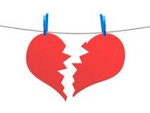 Brocken heart  on rope Stock Photography