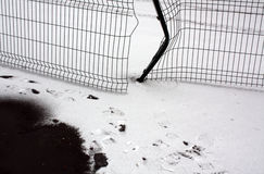 Brocken metal fence and snow. Stock Images