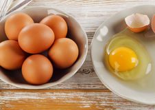 Brocken raw egg on a wooden background Royalty Free Stock Images