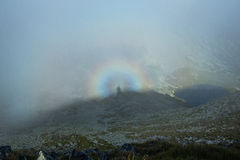 Brocken spectra in the mountains Stock Photo