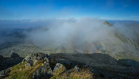 Brocken spectra in the mountains Stock Photography